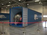 Собранные кузова автомобилей привозят на завод в контейнерах